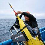 Tyler Rohr readies a Caltech Seaglider for deployment. 📷 Robert Strzepek