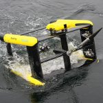 The gaping 'mouth' of the Triaxus as it surfaces for recovery onto the RV Investigator. Instruments such as the LOPC (Laser Optical Plankton Counter, yellow body on the front, top) are located all over the rectangular carbon fibre frame.